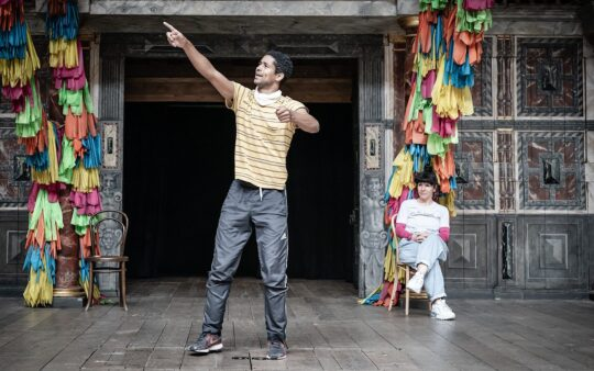 Alfred Enoch as Romeo and Sirine Saba as Nurse in rehearsals for Romeo & Juliet, Globe Theatre, Shakespeare's Globe, 2021. Photographer: Marc Brenner